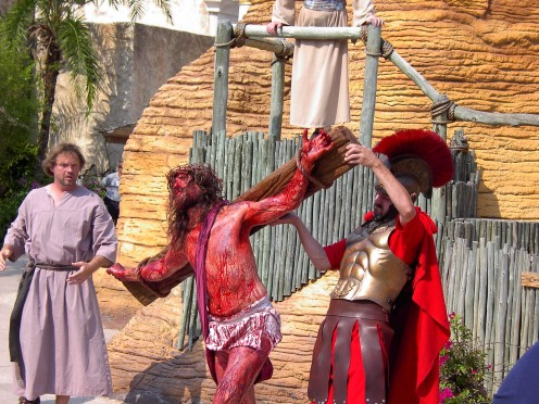A Roman soldier gives a blood-drenched Jesus a hand at the Holy Land Experience theme park, Orlando
