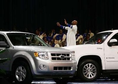 Prayer over SUVs in Detroit megachurch, Dec. 7, 2008. Photo via pamshouseblend.com