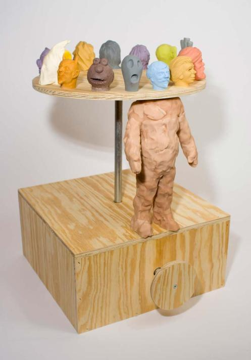 Dan Webb. The New You Machine.  Sculpey, plywood and metal, 2009. 23 x 15 x 18 in.