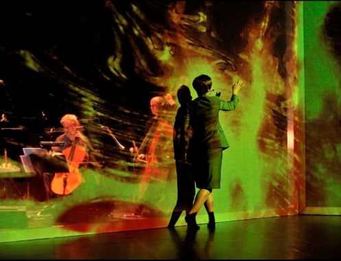 Soprano Charlotte Ellett strives to understand higher dimensionality in a scene from Hypermusic Prologue. Photo copyright Aymeric Warme-Janville, via Seedmagazine.com.
