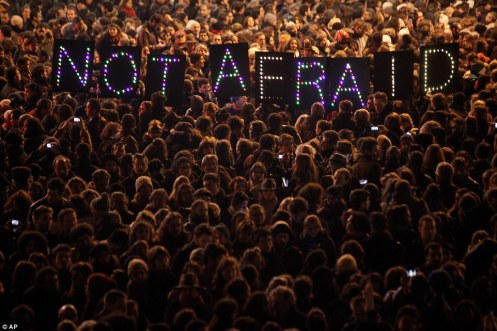 Protesters hold a vigil in Paris in the wake of the Charlie Hebdo attacks, January 7, 2015